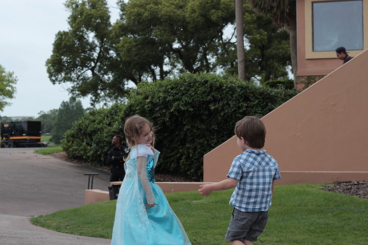 Little girl and boy playing outside