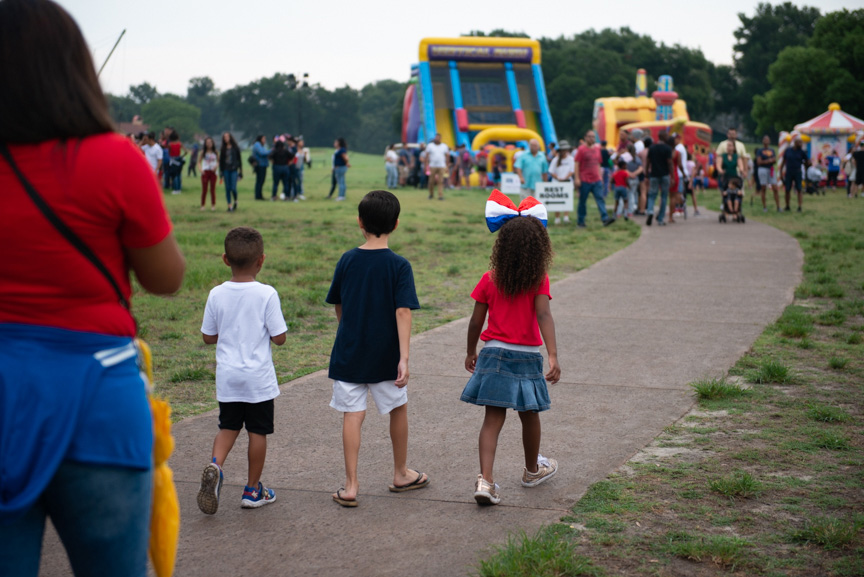 Children walking to bounce house and inflatable slide
