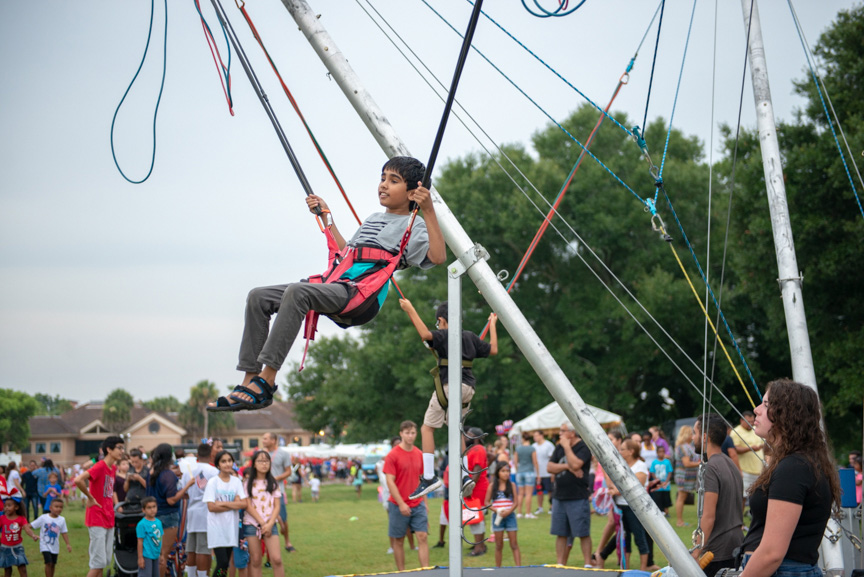 Boy on bungee ride during music works festival