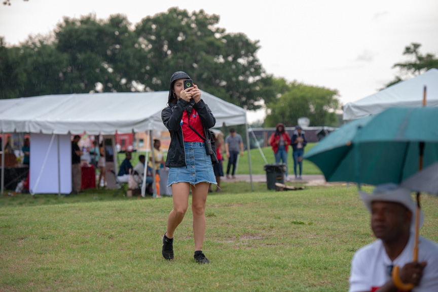 Woman taking photograph at festival