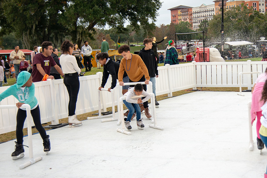 Families ice skating outside