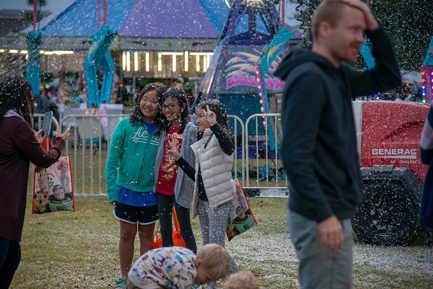 Girls enjoying snowflakes during winter fest