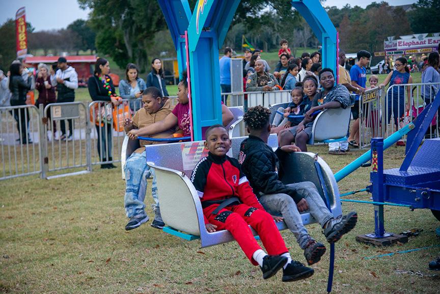 Boys on amusement ride during winter fest