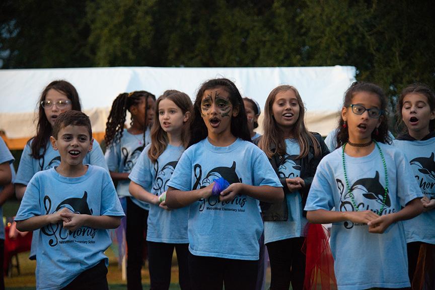 Children singing at winter fest