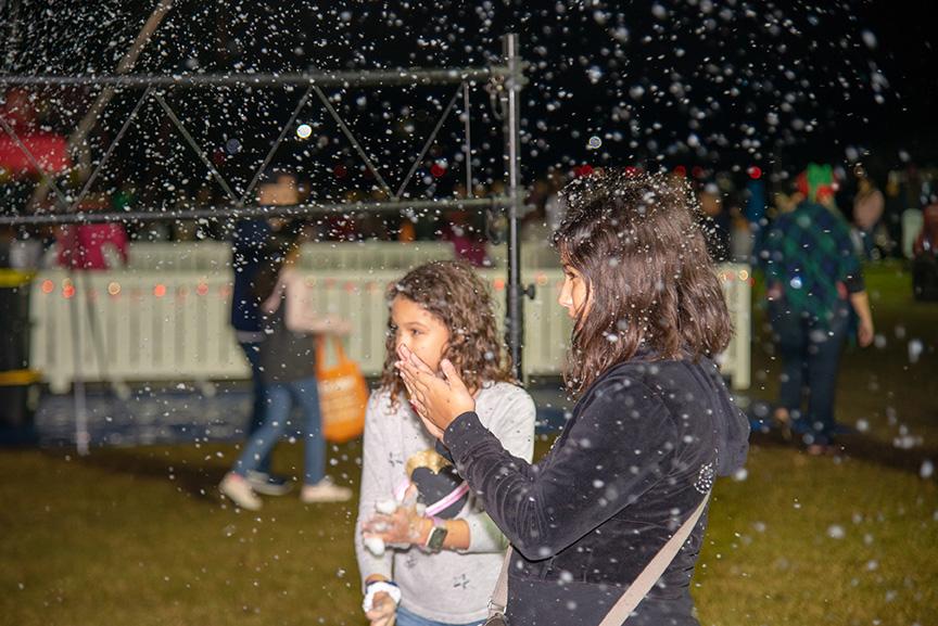 Girls enjoying showflakes during winter fest