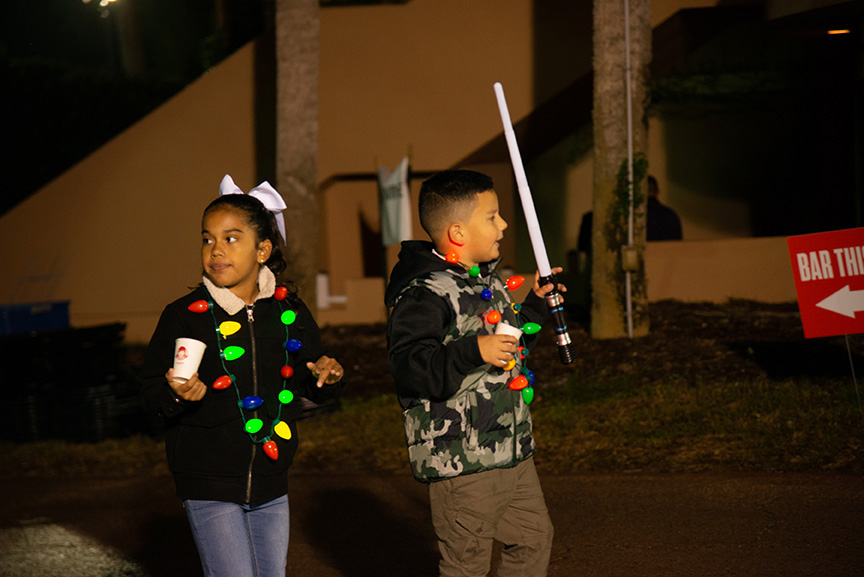Little girl and boy dressed for Christmas