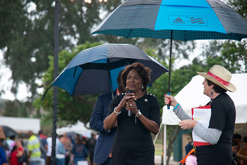 Val Demings speaking at microphone during winter fest